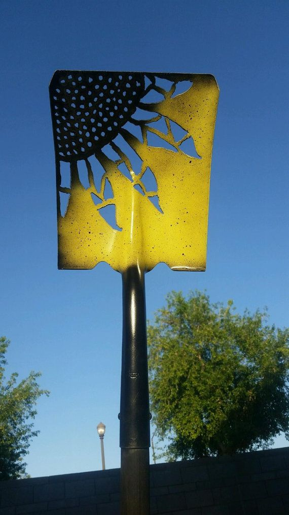 This listing is a hand cut sunflower design in a metal shovel head... The shovel is painted a satin yellow and flat black. Shipping is $15 for the shovel head and $25 for the whole shovel.