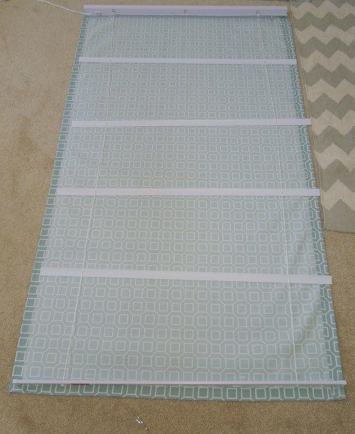 Love the idea of using cheap miniblinds.  But needs to be sewn and not glued. And needs lining.