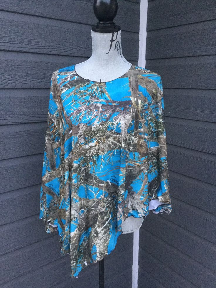 Very flattering handmade poncho type top, has side slits making it easy to wear under a jacket!  One size fits many.  Super cute with leggings of a pair of skinny jeans