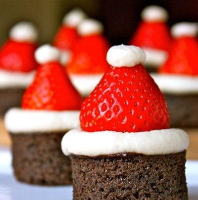 """Santa Hat Brownies at Daisy's World...""""can use ready-made brownie bites or bake a pan of your favorite brownies. I whipped up some vanilla-mascarpone buttercream to simulate the white trim on the hats. Voila!"""""""