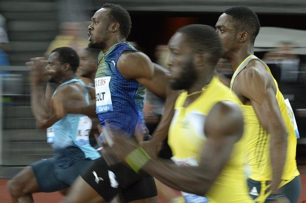 Usain Bolt from Jamaica, centre, competes in the men's 100m race, during the Weltklasse IAAF Diamond League international athletics meeting in the Letzigrund stadium in Zurich, Switzerland, Thursday, August 29, 2013.(AP Photo/KEYSTONE/Steffen Schmidt)