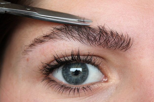Once you've plucked, use a spoolie brush to brush up your brows. Any hairs that stick up above the brow line can be trimmed with a small pair of nail scissors.