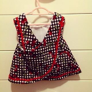 The gorgeous cherry\checker criss cross top made by Zaylie_Co