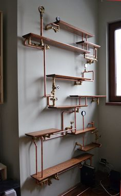 This copper pipe bookshelf. | 18 Steampunk Decor Flourishes That Will Make Any R…
