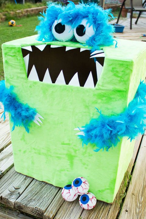 """""""Feed the Monster"""" Halloween Game: This one is easy to make and so much fun to play! Plus, the monster doubles as a winning Halloween decoration and a cool game. Click through to find more easy and fun Halloween party games for kids."""
