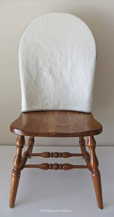 Cotton linen topper custom made for outdated Windsor dining chairs.