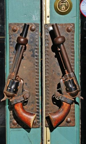 @Kim Renaud ... I thought you'd think this was neat. Door Handles out of old west style guns. For the bar or something ... or just because they're neat. lol