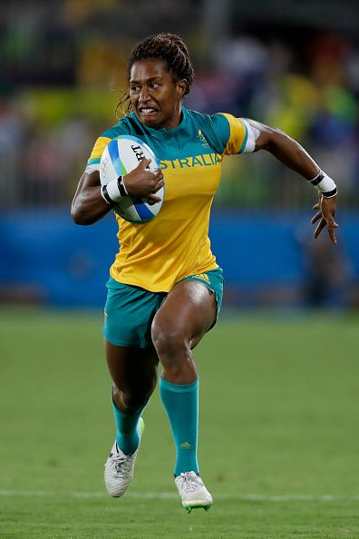 Ellia Green of Australia runs with the ball during the Women's Gold Medal Rugby Sevens match between Australia and New Zealand…