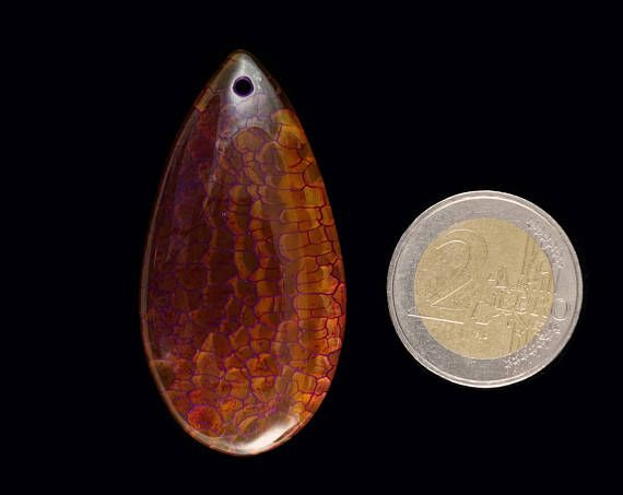 A natural Dragon Veins Agate pendant stone.  Size 52x27x7 mm  Refunds and Exchanges:  If you are not satisfied with your purchase for any reason, please contact me before leaving a feedback.  You can return purchased items without giving a reason within 14 days from the day you got it - just give me an information and send it to the address given below.   Shipping from Poland to destinations in Europe take about 7 days. Shipping to United States, Canada and Australia takes 10 - 20 days…