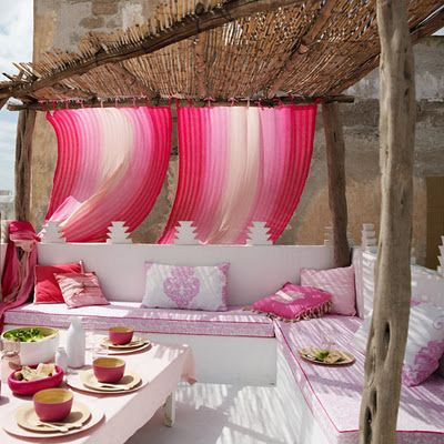 Moroccan inspired seating area with built in banquettes and clever parapet design