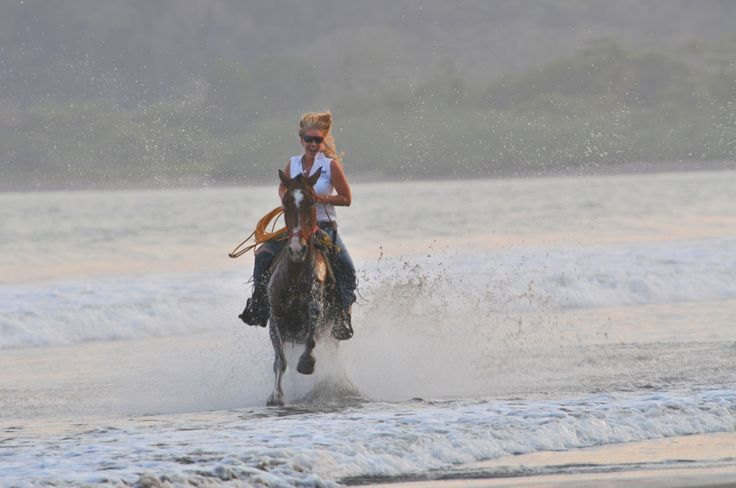 Riding with the sunset in Playa Tambor, Costa Rica.