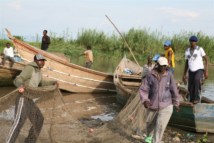 Fishermen prepare their nets and boats to set out fishing in Kasenyi, DRC