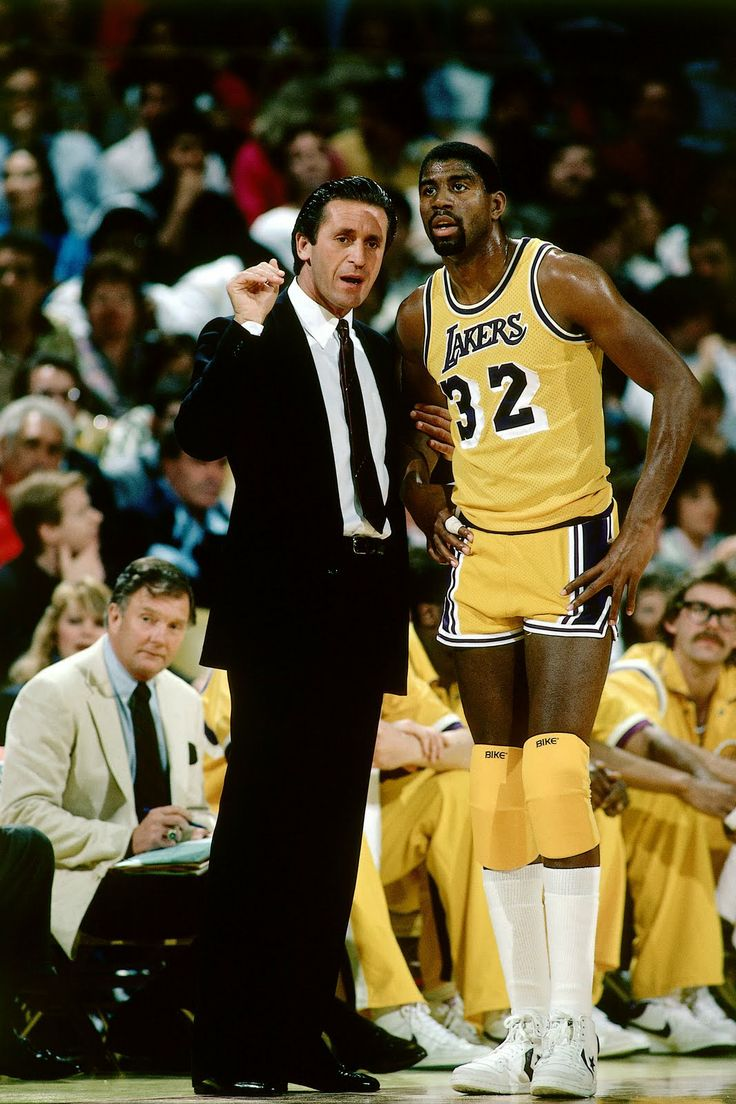 Pat Riley and Magic Johnson- 1984    Haha. Those knee pads!  Oh come on, you know you tried to rock them once too!