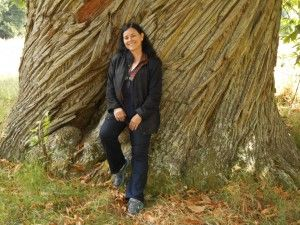 Diana Gabaldon at Castle Leod, Scotland, standing in front of tree planted by Mary of Guise (this would be Mary, Queen of Scots' mother_) in 1500.