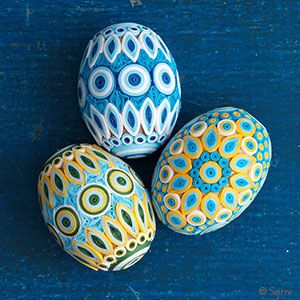 Remarkable in detail and craftsmanship, this set of 3 wooden eggs is covered with dozens of individually coiled paper details in lively colors and patterns. Flat bottom, can stand upright. each: 2 1/4h