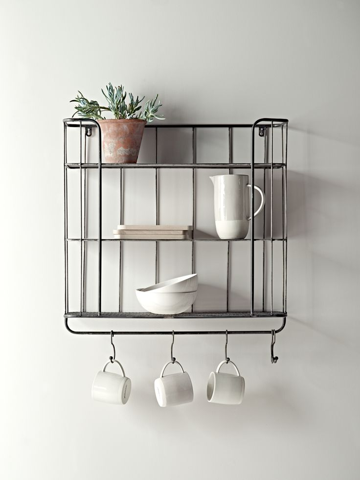 Store your essentials in style with our clever shelf unit. Inspired by the industrial trend, each rustic metal shelf has two solid shelves and one bottom mesh shelf, plus five hooks for hanging, making it ideal for storing your mugs and dinnerware.
