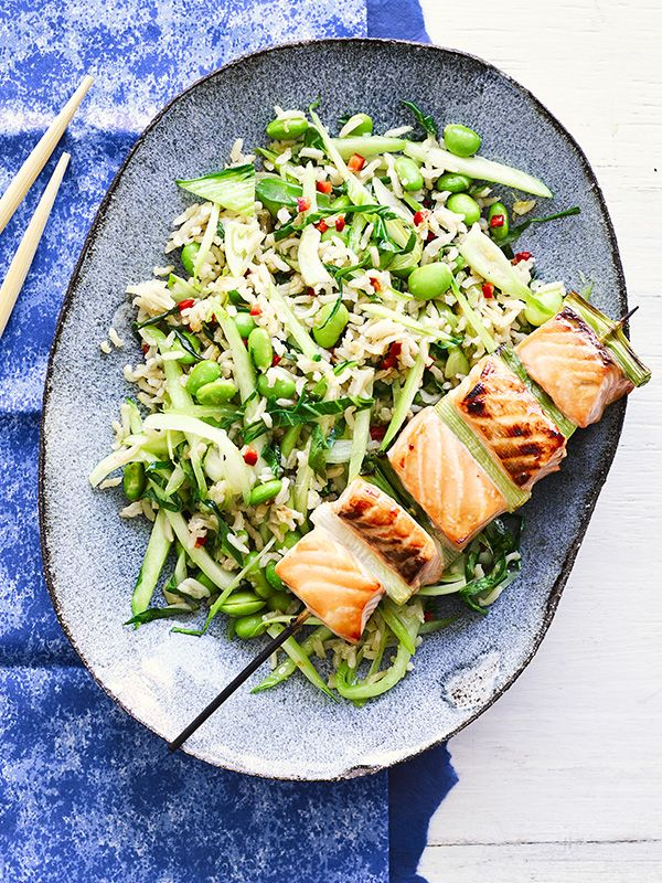 This recipe for salmon yakitori with stir-fried brown rice is low-calorie, low-sugar and ready in under 30 minutes - perfect for a speedy midweek meal.