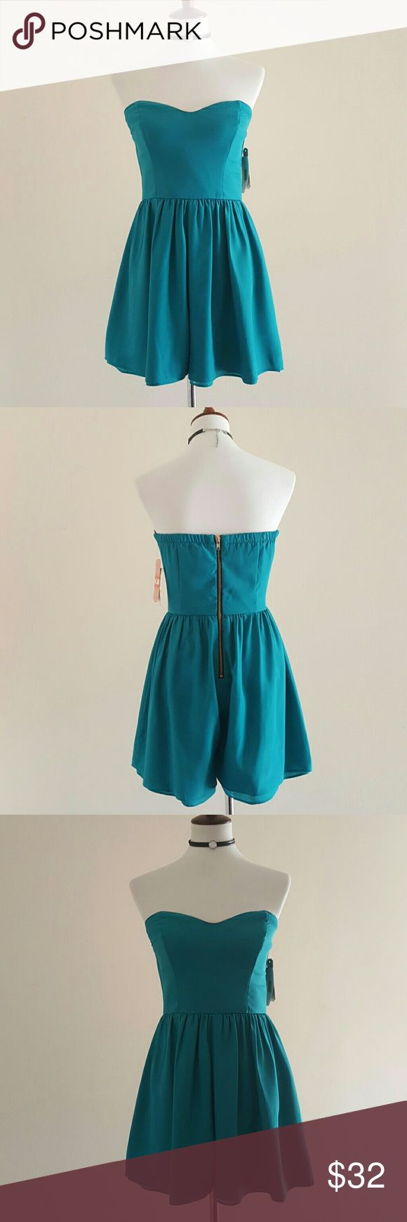 Gianni Bini Teal Strapless Romper Strapless romper w/ ivory lining on a sweetheart neckline. 25' in length from top to bottom hem.  Gold zipper in back. This is a size 7. Laying flat the waist measures 14'.  Super cute for a night ouT! 100% polyester Gianni Bini Pants Jumpsuits & Rompers
