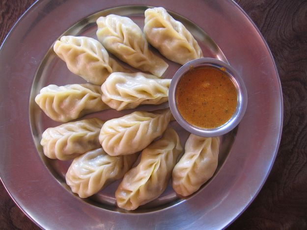 Momos | 26 Traditional Indian Foods That Will Change Your Life Forever   What It Is: A variation on the traditional dimsum, native to North East India, eaten with a fiery red chutney.  Perfect For: A quick mid-evening snack. Feels Like: Kicking your shoes off after a long day and settling into your couch for hours of TV.