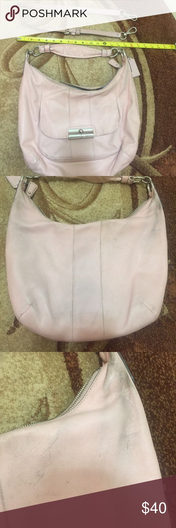 """Blush pink Coach hobo crossbody Used Coach hobo, has short shoulder strap with detachable crossbody strap. Crossbody strap measures approx 32"""". This bag HAS WEAR. I tried to show in the photos. Bottom """"corners"""" of bag have wear/slight color transfer. Back of bag has wear and color transfer. Third photo shows back of bag at top right (I wear it on my right side so this is the part that rubs on back of jeans, etc. I have wiped it down but not tried cleaning it as I don't  want to ruin the…"""