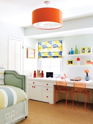 floating shelves, orange louis ghost chairs, and greek key bed skirt