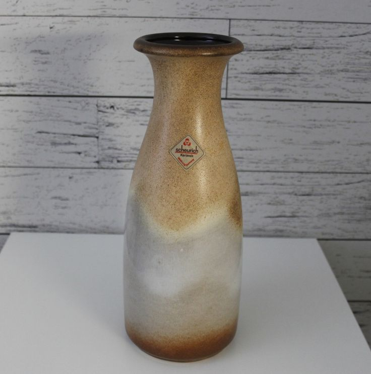 "West German vase by Scheurich from the 1960's, beautiful glazed outside with jade like beige, cream, nut brown, and Chocolate brown glazed inside.   Condition: Excellent vintage condition, with a label, Scheurich No chips Nor cracks.   26cm high/10.2"" inch High Diameter: 10 cm /, 3.93""  Markings: Scheurich Keramik W.Germany 293-26  See more collectible ceramics please see. https://www.etsy.com/se-en/shop/ScandicDiscovery?section_id=17132218&ref=shopsection_leftnav_5"