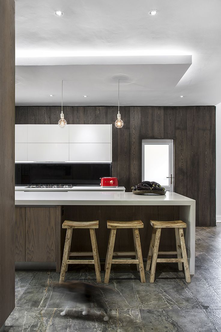 Kitchen trends. Mix slick with natural wood. Handle-less units. Dark floors. The industrial look. Clutter-free worktops. Clever storage solutions. Kitchen organization. Monochrome tones. Copper accents. Mix old and new.