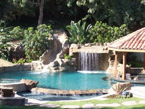 Freeform Pool With Artificial Rock Grotto Water Slide Swim Up Bar Covered Gazebo