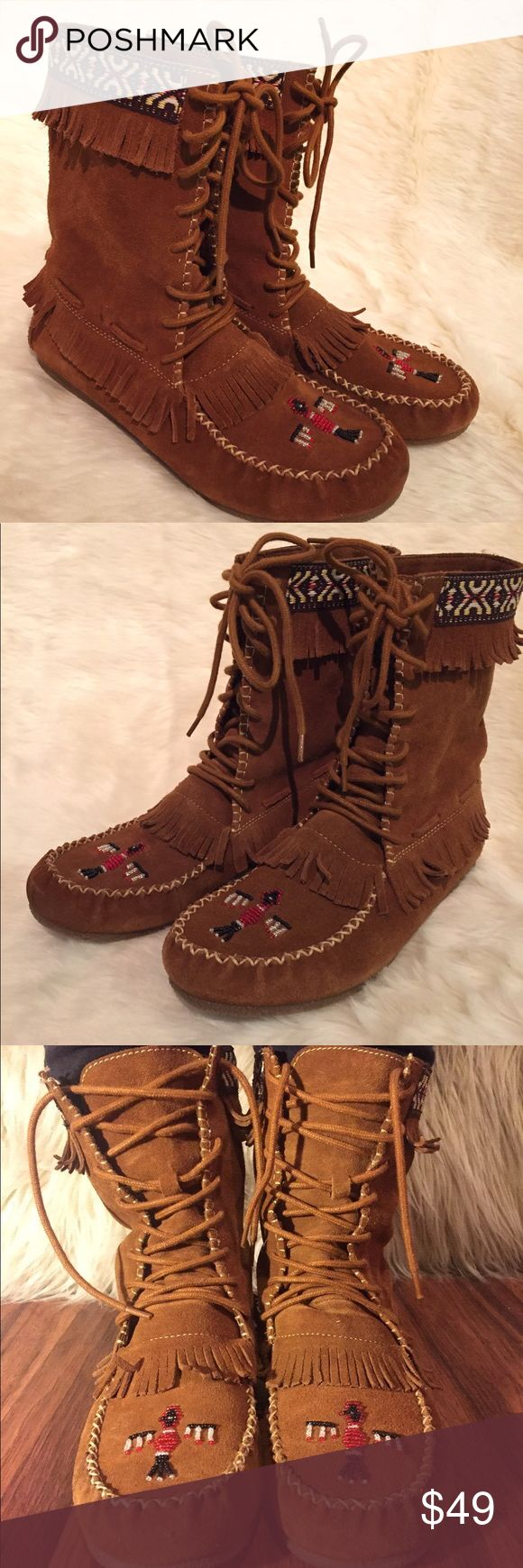Minnetonka Thunderbird beaded moccasin boots Beautiful suede leather and beaded bird made these moccasins a must have. Lace up front, fringe, cross cross stitching, and detailed embroidery lining top. Quality design. These boots are in good condition and have been well cared for. Worn less than a handful of times. Unfortunately they are just a little big for me (I'm usually a 7.5/8, but my size was sold out).  Style number 8466 Size: 8.5 Color: dusty brown  Check out my closet for more great…