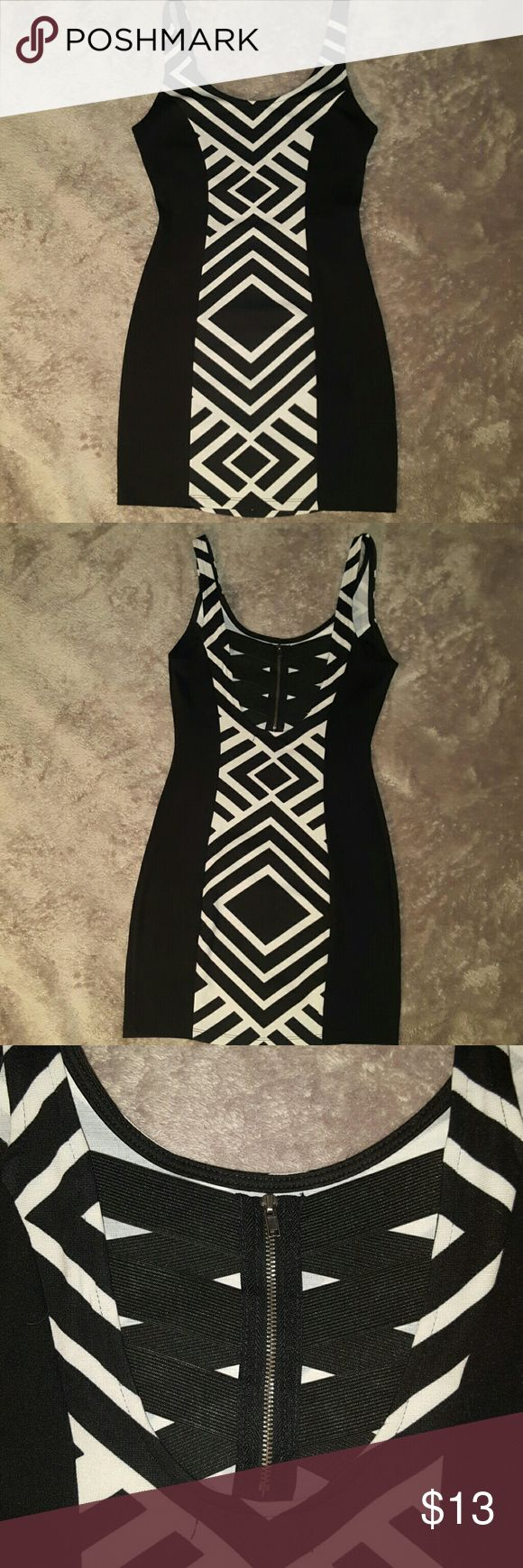 Black and white mini dress Material Girl Trendy print. Never worn. Perfect condition. Cute back scrappy detail where the dress zips up. Bundle and save! Material Girl Dresses Mini