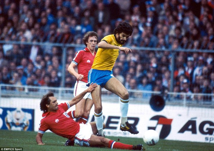 The great Socrates evades a tackle from Ray Wilkins during a friendly match between England and Brazil at Wembley in 1981 - a goal from Zico gave Brazil a 1-0 win