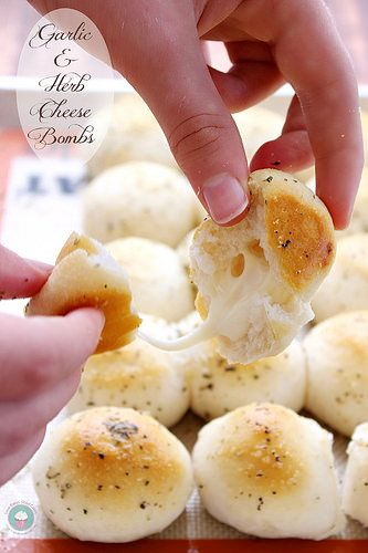 Garlic & Herb Cheese Bombs - cheesy deliciousness wrapped in refrigerated biscuit dough, brushed with butter, garlic and herbs! #cheese #appetizers #bread