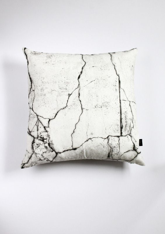 Cushion cover with CRACKS print on front and back, part of the collection MAKING HARD THINGS SOFT.
