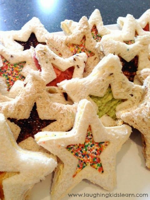 """Seeing Stars: Make """"window sandwiches"""" using two cookie cutters of the same shape but different sizes. (Skip the sprinkles to make this a healthy option.) Find more cute, easy, low card, gluten free and healthy Christmas snacks ideas for kids here."""
