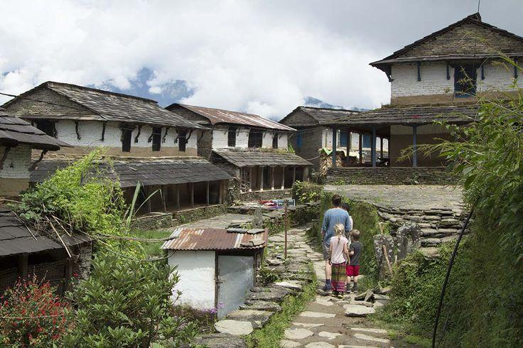 Family walking through Dhampus village, Nepal