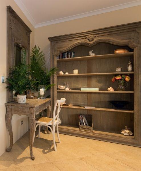 Study nook with oak bookcase, mirror, desk/console.