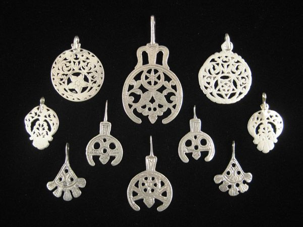 Africa | Old pendants from North Africa, all very high quality silver | Collection includes pieces from Tunisia, Egypt and Libya.