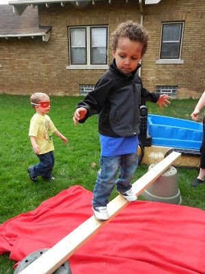 Find a long, skinny board, two buckets, and you have a practice balance beam!  Try this in the summer!
