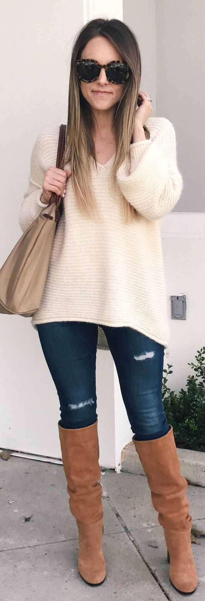 #winter #fashion / White V-neck Knit / Ripped Skinny Jeans / Brown Boots