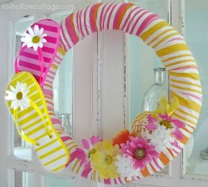 Make a decorative wreath out of a pool noodle.  Wrap it with fabric or yarn.  Attach Velcro, and the wreath decorations can be interchangeable.