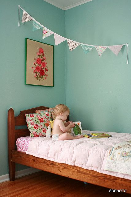 Love the colors for a girl's room, but does anyone else panic at the sight of a little baby so close to the edge of the bed?!