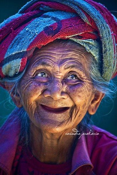 joyful smile of a Balinese woman.