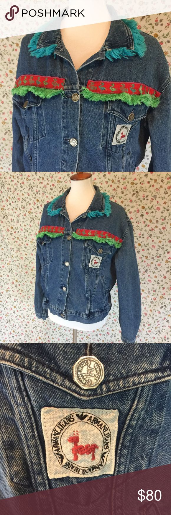 """Vintage 80's 90's Armani Jean Jacket Fringe Alpaca Vintage Armani Jacket, made in Italy. Alpaca logo on buttons, ribbon detail and breast. Also features colorful fringe around lapel and across chest. Elastic detail at back/sides of jacket. Size says """"Taglia 44."""" Approximately a women's size medium, shown here on a size 6 model. Overall good vintage condition with no flaws.      Bust/armpit to armpit, laid flat unstretched: 21.5""""     Length from collar to hem: 20.75""""     Sleeve length: 23""""…"""