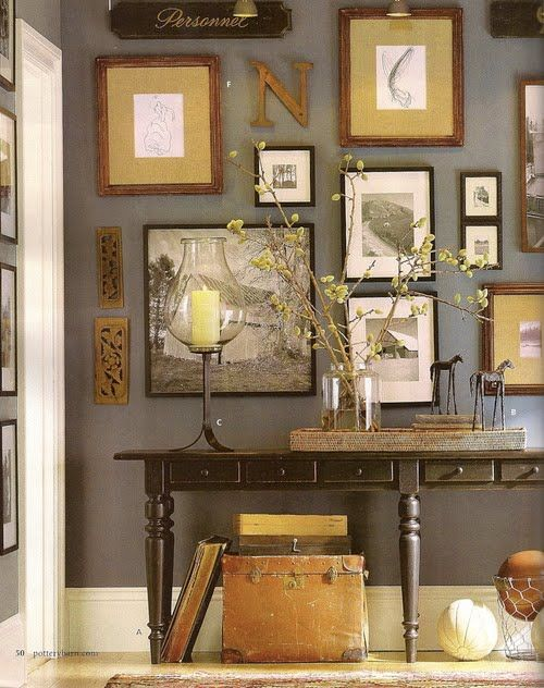 The gold, browns, and greys in this gallery wall really appealed to me. (I've been searching out well done gallery walls for ideas for my house, and this one has the eclectic mix of framed art and more tactile items, united by a good color scheme, that I like.)