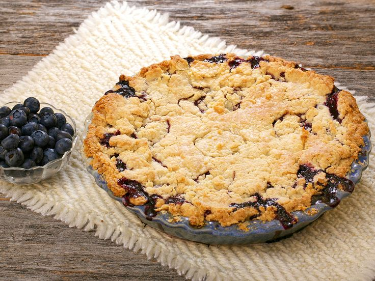 "Savor in the sweet, down-home goodness of Blueberry Cobbler, a thick and flaky outer crust with a hot center brimming with fresh blueberries. To prepare: 1. Melt butter in the bottom of an 8""x8"" baking dish. 2. In a bowl, sift together flour, sugar, baking powder and salt. Slowly stir milk and almond extract into the dry ingredients until just mixed. 3. Pour batter over the melted butter. Pour fruit on top, spreading across the pan evenly. 4. Bake at 350 for 45 minutes to an hour."