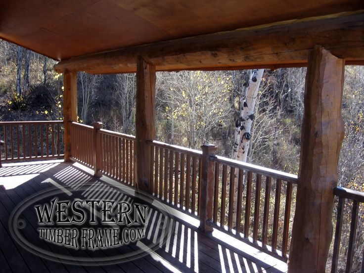 Neff Cabin with covered timber decks, posts and beams, and railing.