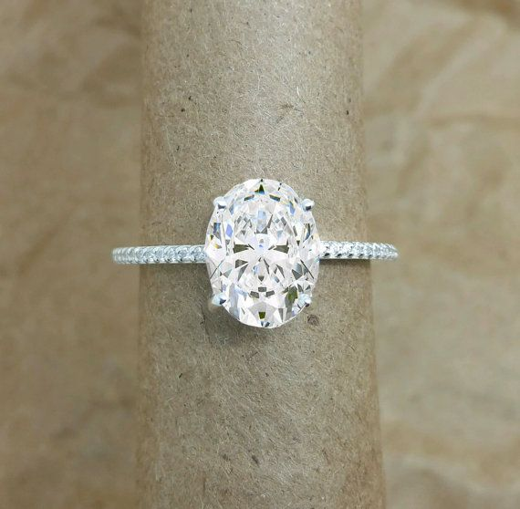 custom Package for dawn. Oval engagement ring. featuring diamonds and Forever brilliant moissanite.