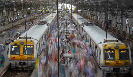 Commuters disembark from crowded suburban trains during the morning rush hour at Churchgate railway station on World Population Day in Mumbai. According to a 2011 census conducted by the government of India, Mumbai has a population of more than 12 million with an estimated population density of about 20,482 persons per square kilometer.