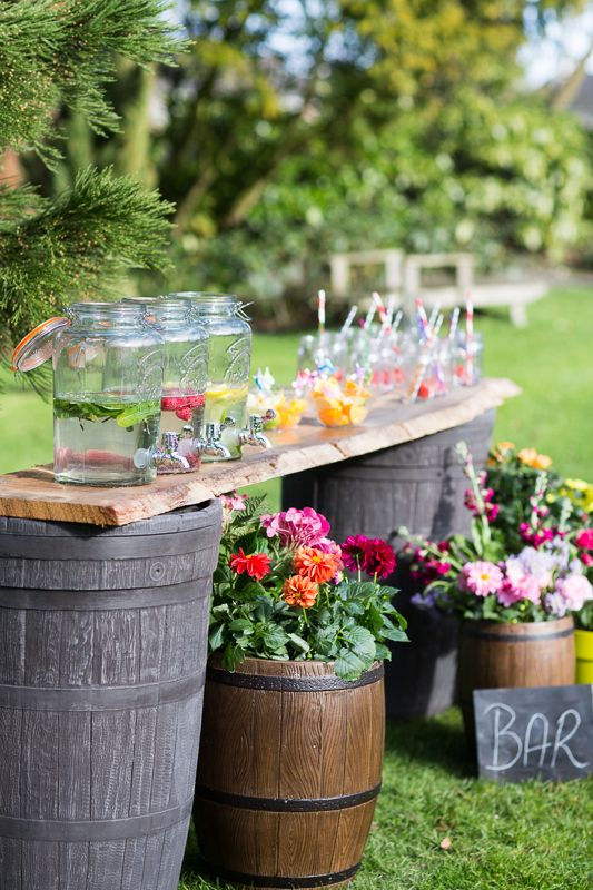 Impress your party guests with your very own garden #bar. It's easy to create using two barrels and a piece of wood to create the counter top.