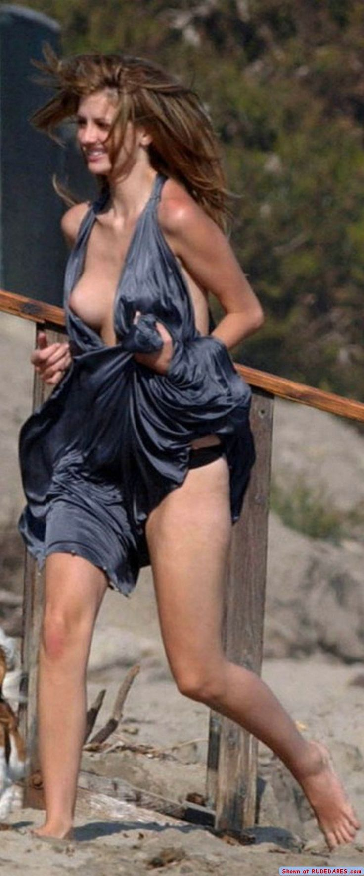 OOPS! OH DEAR! This poor girl has a nip slip and a panty peek!